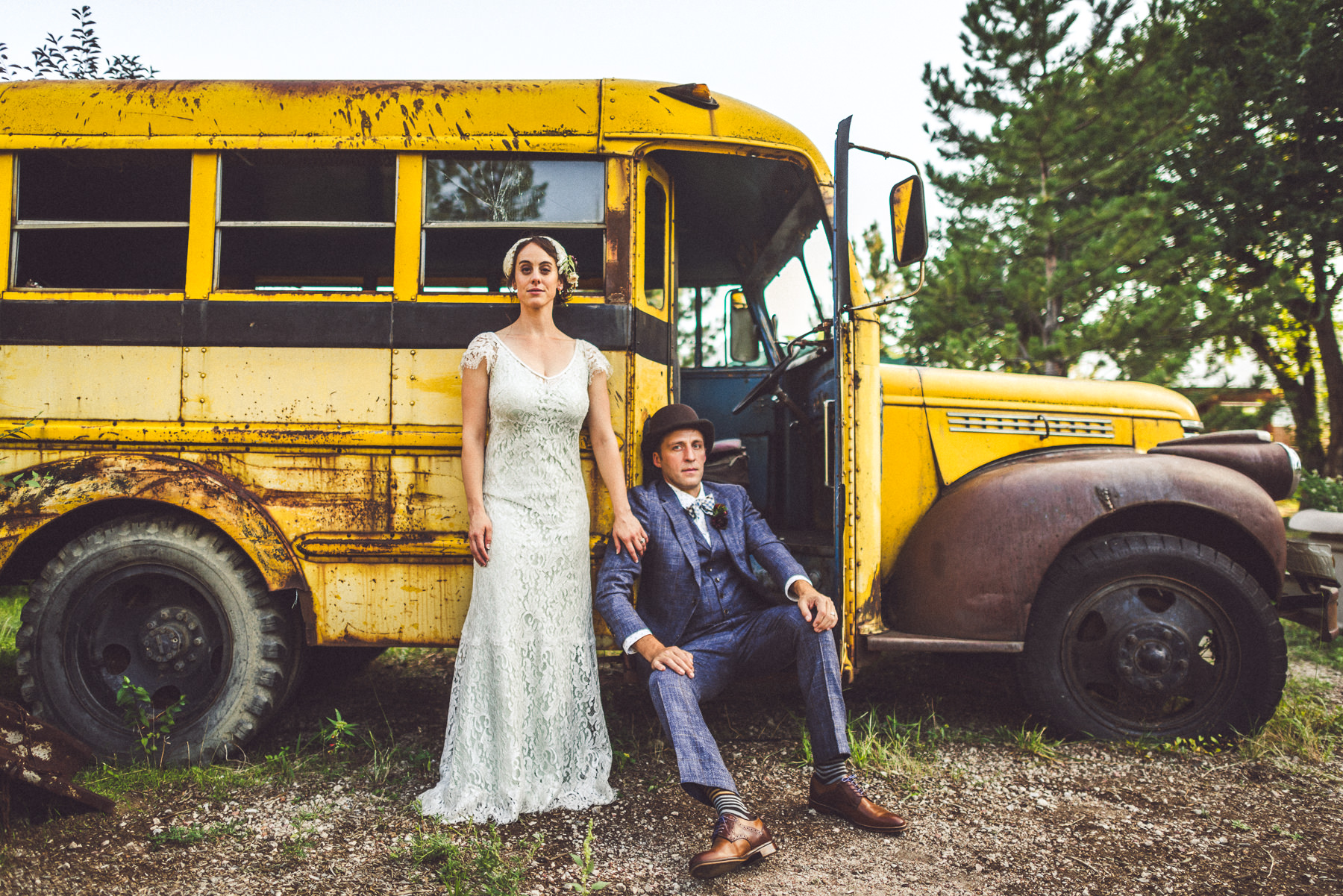 Bride & Groom pose in front of Yellow School Bus at their Hillside Gardens & Events wedding.